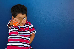 Boy and Blue Wall. 1/60s @ f/4.5