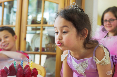 Blowing out the candles. 1/50s @ f/3.5