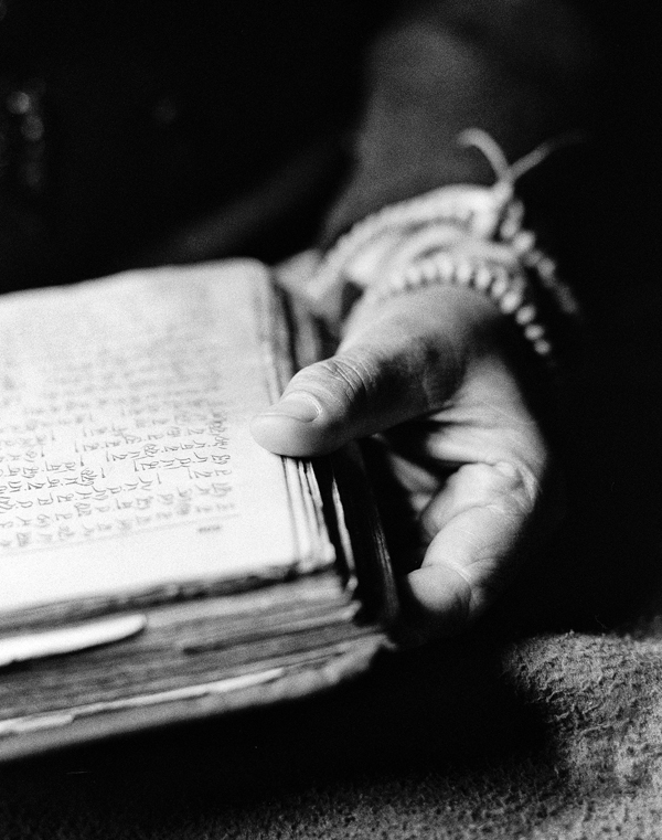 Black and white photo by roy zipstein a hand with a book