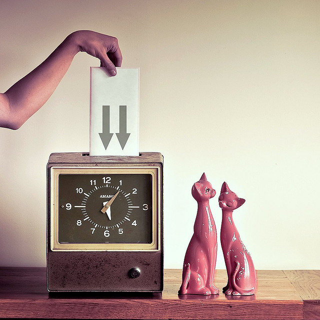 retro clock with two cats in love