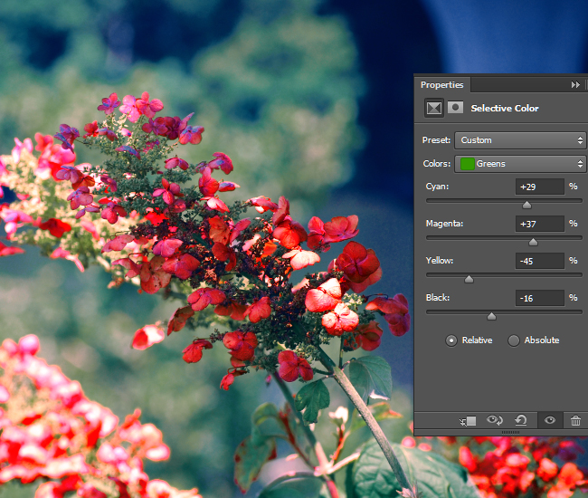 Adjust the intensity of the CMYK values for the green areas of the photo.