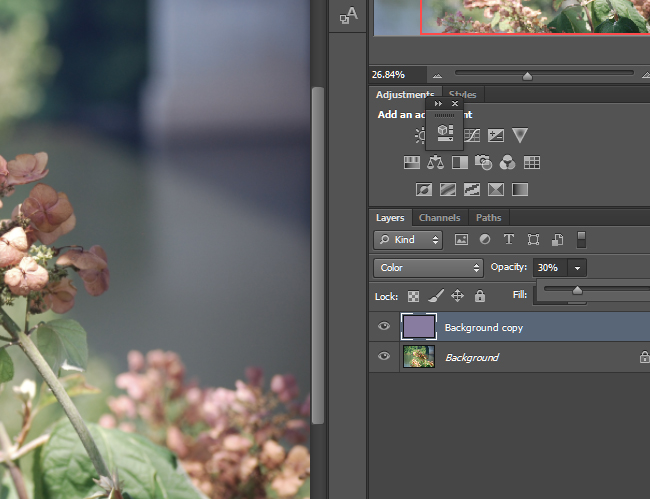 Change the opacity of the layer to 50% or lower depending on how much correction is needed.