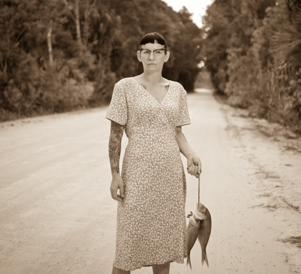 The Grand Prix de la Découverte Prize in People/Portraits The haunting simplicity and timeless quality of this image made a memorable first impression with the jury; then came the added bonus of the strange and elegant details.