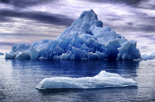 A iceberg floating on the high seas.