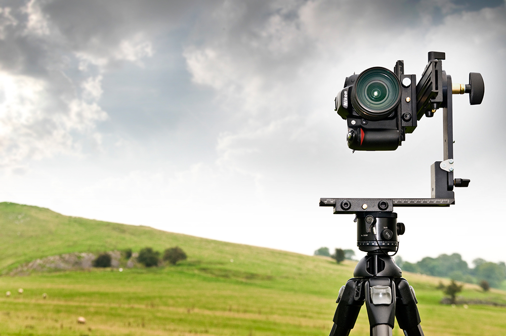 A pano head allows you to take level panoramics by rotating the camera around a fixed point, instead of rotating the camera itself.
