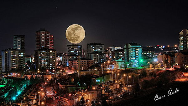 Moon + City Skyline = Success. Photo by Omer Unlu