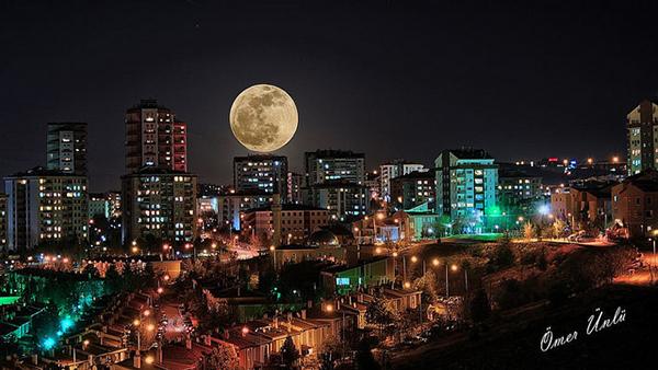 Moon + City Skyline = Success. Photo by Omer Unlu