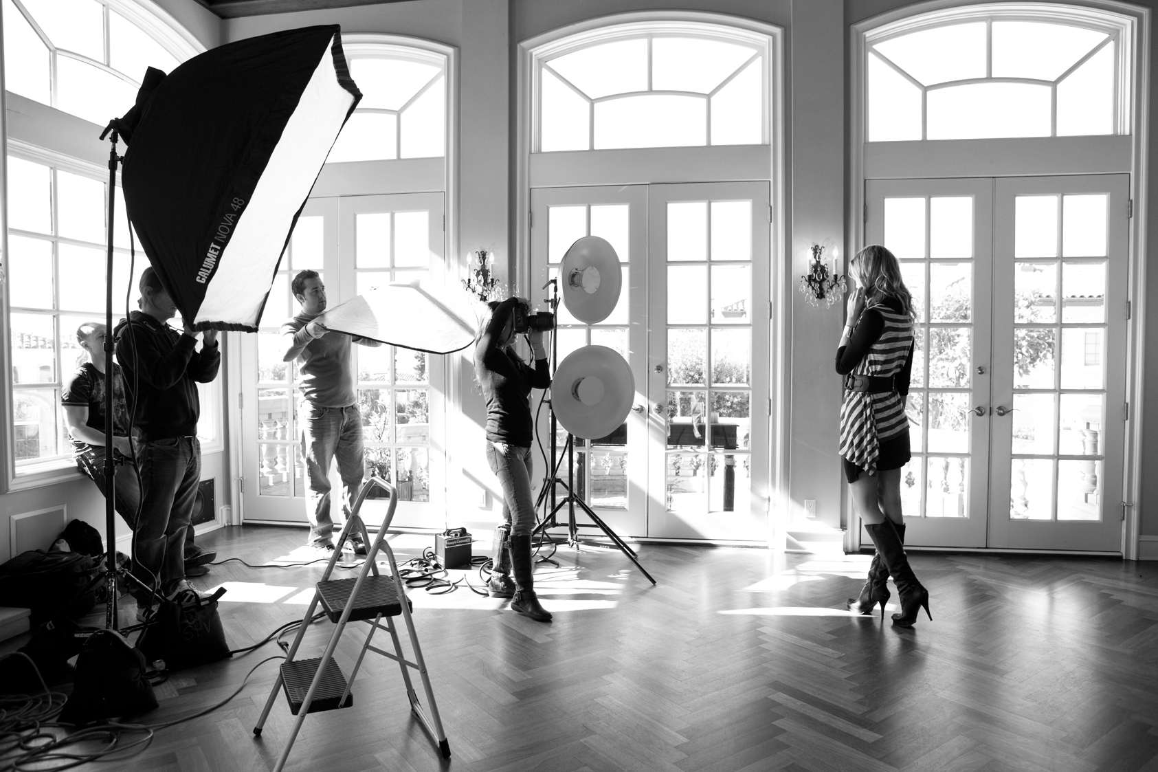 A standard set up, with soft boxes, reflectors, beauty dishes and a good source of natural lighting