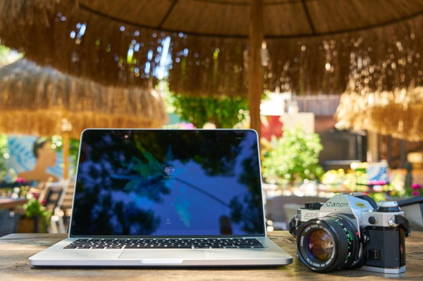 camera and laptop in tropics