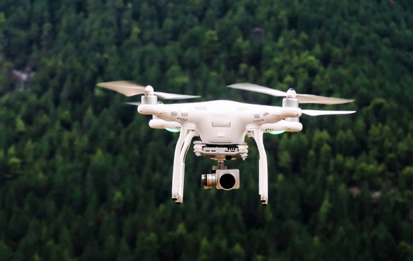 flying drone pointing its camera