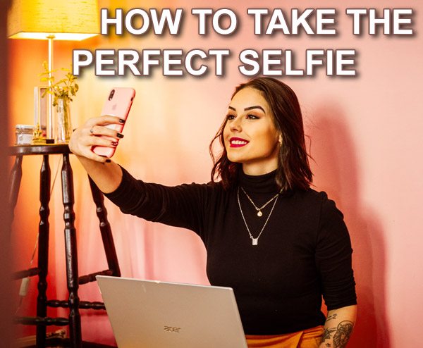 woman taking selfie with artificial light